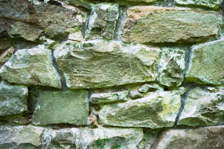 texture of masonry, a fragment of a stone wall of an ancient temple of the 10th century, background, backdrop