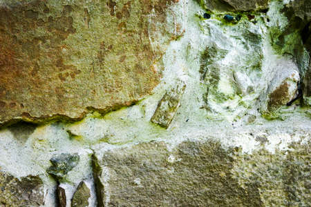 texture of masonry, the fragment of a stone wall of an ancient temple of the 10th century, background, backdrop
