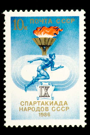 07.24.2019 Divnoe Stavropol Territory Russia Postage stamp USSR 1986 9th Spartakiad of the Peoples of the USSR Runner on the background of a torch Editorial