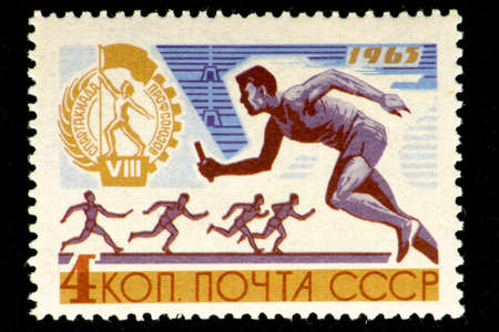 07 24 2019 Divnoe Stavropol Territory Russia Postage stamp USSR 1963 year 8 Spartakiad of the trade unions Runner with an ectafet stick Sajtókép