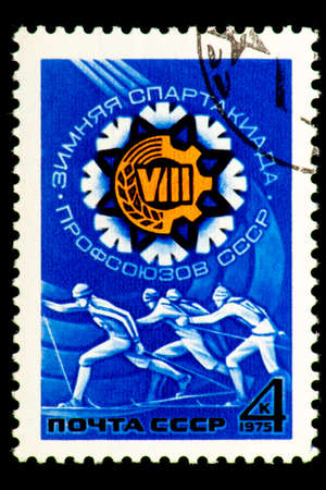 07.24.2019 Divnoe Stavropol Territory Russia Postage Stamp of the USSR 1975year 8 winter sports contest of the USSR trade unions running skiers on the blue background Redactioneel