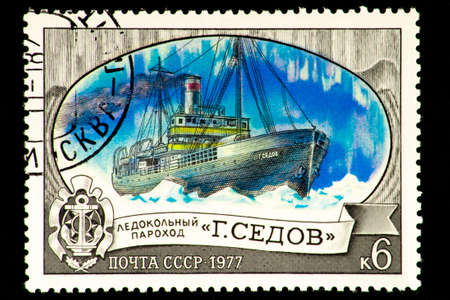 07.24.2019 Divnoe Stavropol Territory Russia postage stamp USSR 1977 icebreaker parachute G. Sedov parachute among the ice Banque d'images - 133075401