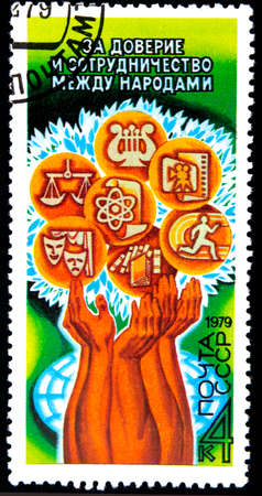 10.24.2019 Divnoe Stavropol Territory Russia 1979 USSR postage stamp for trust and cooperation between peoples hands hold icons symbolizing science art sport