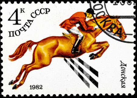 01 16 2020 Divnoe Stavropol Territory Russia postage stamp USSR 1982 series Soviet Horse-Breeding Donskaya breed horse with a rider jumps over the barrier Editorial