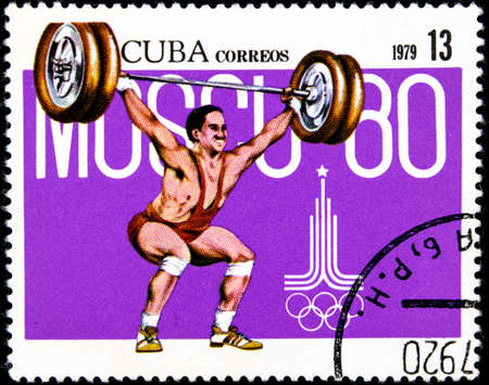 01 16 2020 Divnoe Stavropol Territory Russia postage stamp Cuba 1979 Pre-Olympics, Moscow 1980 weightlifting weightlifter lifts the barbell on a purple background Redakční