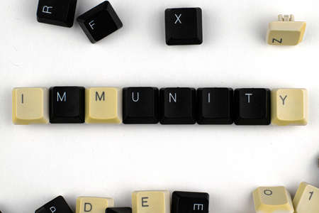 concept virus remote work computer word immunity laid out from keyboard keys