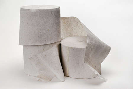 three rolls of toilet paper on a white background