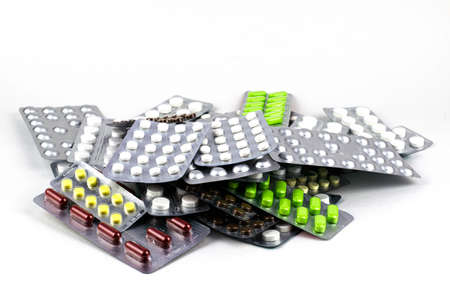 big pile of different pills in blisters on a white background Stok Fotoğraf