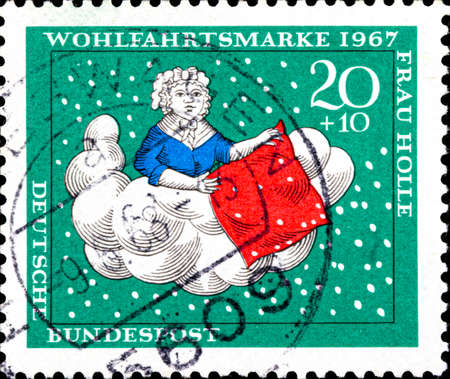 02 10 2020 Divnoe Stavropol Territory Russia Germany postage stamp 1967 Charity Stamps - Fairy tales Welfare: Stories of the Brothers Grimm Frau Holle in the clouds Sajtókép