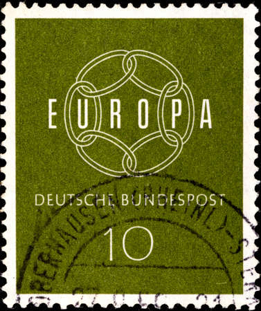 02 09 2020 Divnoe Stavropol Territory Russia postage stamp Germany 1959 EUROPA Stamps Closed Chain A closed chain of six links on a green background Éditoriale