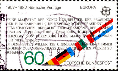 02 11 2020 Divnoe Stavropol Territory Russia German postage stamp 1982 EUROPA Stamps - Historic Events Excerpt from Treaty of Rome instituting EEC , 1957, and flags