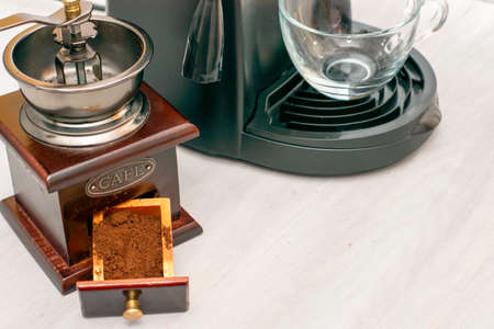 a coffee machine and coffee grinder are on the table