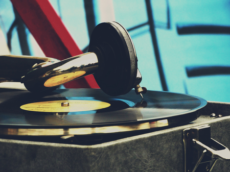 60's: The old gramophone on the table vintage retro rarity style 30s 40s 50s 60s closeup vinyl needle song music time melody generation