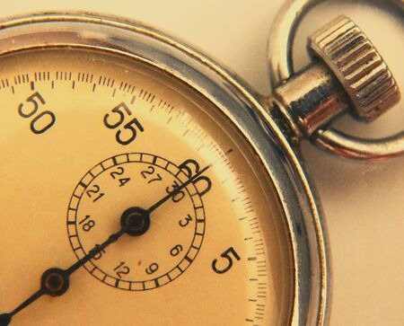 antiques: stopwatch retro vintage antiques macro closeup wallpaper background value measure time old clock arrow minute second accuracy timer record Stock Photo