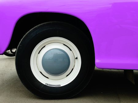 Old retro car on exhibition 40s 50s 60s vintage style time generation rarity background wallpaper purple Stock Photo