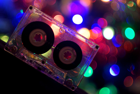 Audio tapes for tape recorder 70s 80s 90s bokeh vintage fashion old retro wallpaper background closeup nostalgia music sound style Foto de archivo