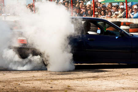 Car is drifting in front of crowd Stock Photo - 11240764