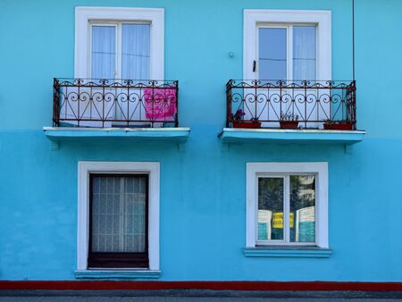 Fragment of the blue facade of a two-story house