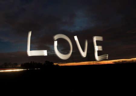 Love word light painting night sky color