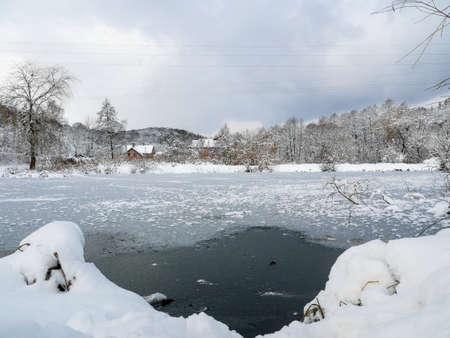 Evening on an frozen lake ice snowy Archivio Fotografico