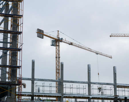Construction crane working tower building city photo Archivio Fotografico