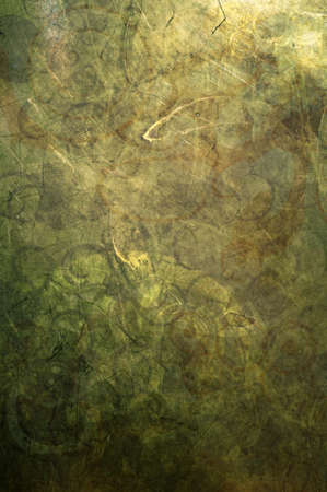 predominantly: An abstract grunge texture that is predominantly green and gold.