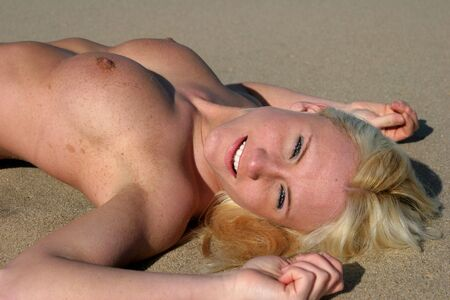 Topless beauty relaxes on a beach (gunnison beach NJ) Stock Photo - 3783617
