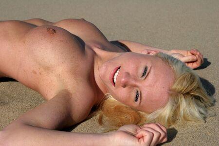 Topless beauty relaxes on a beach (gunnison beach NJ) Stock Photo - 3783617