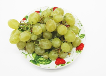 green grapes on a plate. top view photo