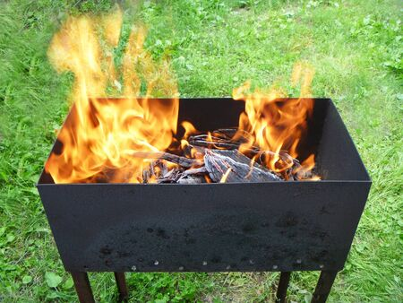 blazes: Mangal with languages of the flame Stock Photo