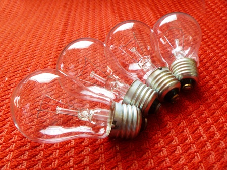 socle: Electric light bulbs on red background