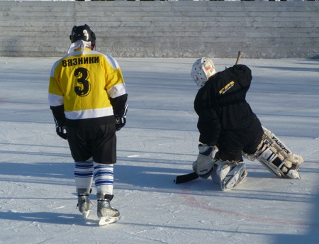 Hockey play of the commands on skating rink outdoors