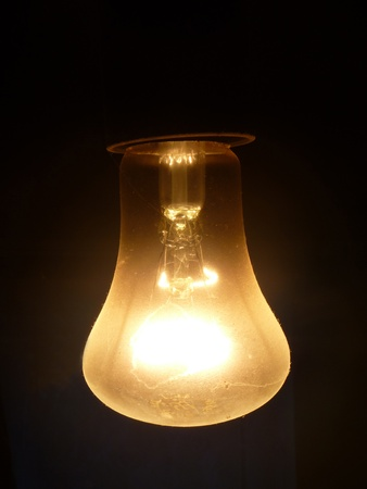 socle: Dusty light bulb on dark background