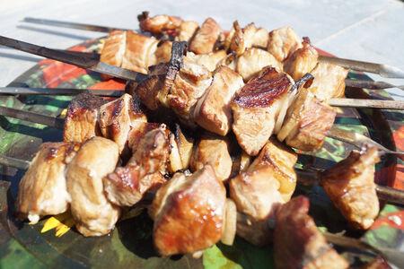shish kebab: Meat shish kebab on table