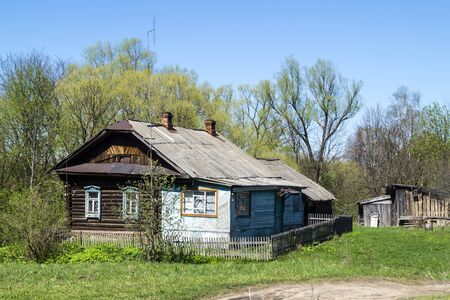thrash: Farmhouse on background blue sky in Russia Stock Photo
