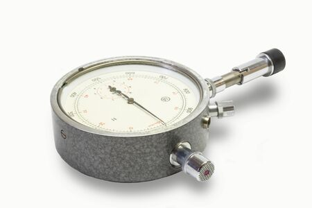 tachometer: Mechanical tachometer with arrow is insulated on light background