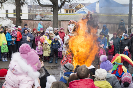 effigy: Mstera,Russia-March 13,2016: People look what blazes effigy in holiday of the Shrovetide March 13,2016 in city Mstera,Russia Editorial