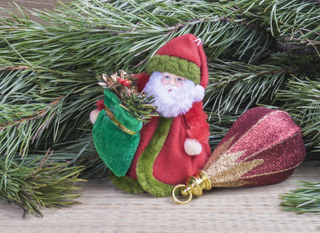 caftan: Grandparent Frost with toy for fir tree on background of the green branches with needle Stock Photo