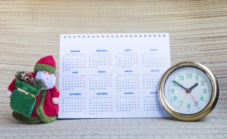 grandparent: Grandparent Frost with paper calendar and round hour on beige background