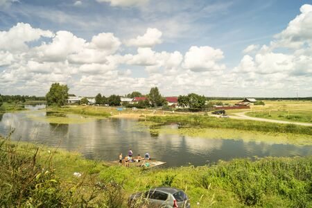 repose: Mstera,Russia-August 5,2016: People bathe and repose in river beside villages on August 5 2016 in Russia Stock Photo