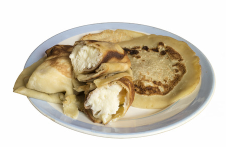 insulated: Home pancakes with white pot cheese for morning meal is insulated on blue plate