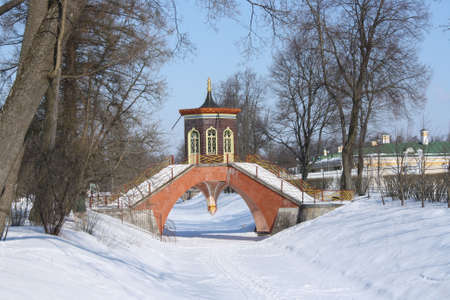 decorative bridge through the channel with a small pavilion