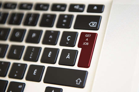 richer: Picture showing a computer keyboard where GET A JOB is written Stock Photo