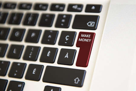 richer: Picture showing a computer keyboard where Make money is written Stock Photo