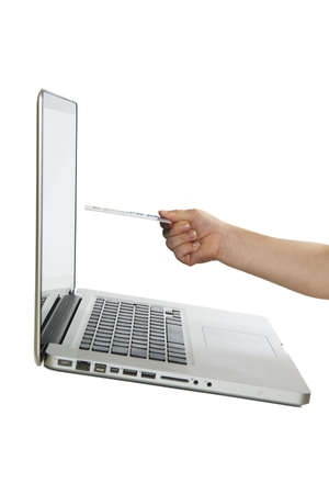 ordinateur: A little kid s hand holding a credit card in front of a laptop