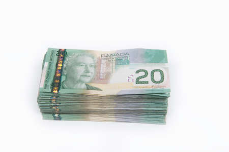 canadian dollar: A lot of Canadian twenty dollar bills isolated on a white background