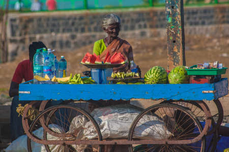 Woman selling fresh fruits on the beach in Mamallapuram, Tamil Nadu, India. Editorial