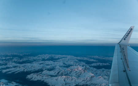The Boeing 737-800 of the company Ryanair flying between italian Alpes Editorial