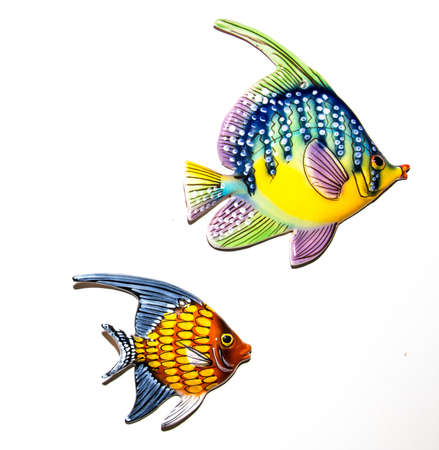 fishes: Toy fishes on white background