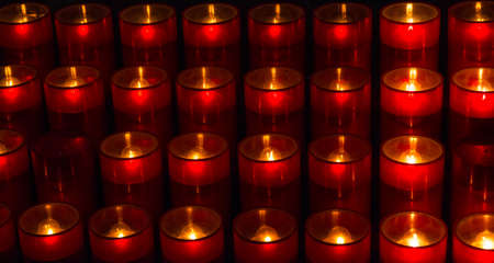 Votive candles in the church Stock Photo